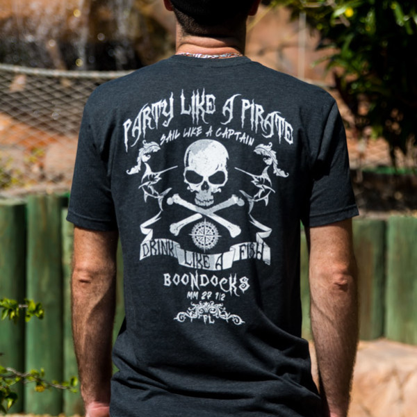 short sleeve tee shirt in charcoal grey with the words party like a pirate, with skull and crossbones. white lettering