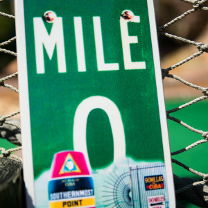 green sign with mile 0 in white letters southern most point marker